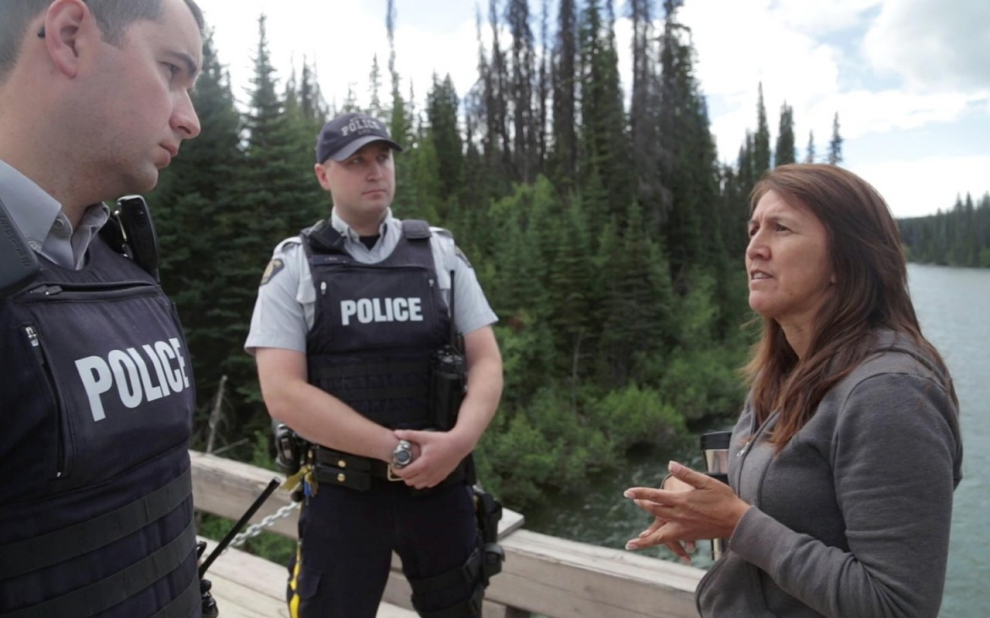 Freda Huson confronts RCMP officers on the bridge to traditional Unist'ot'en territory. Michael Toledano